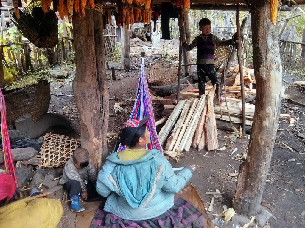 Weaving mats in Nandai village