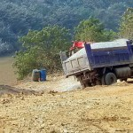 Truck with gravel almost tipping over