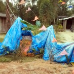 The Christians on this island are making cribs with tarp, some with more success than others