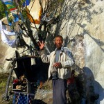 Dongba shaman blessing people