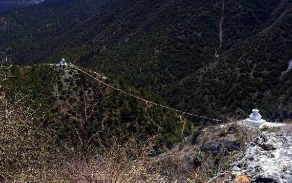 Tibetan prayer flags spanning the craziest gaps