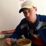 Sandy enjoying a bowl of Tengchong Ersi
